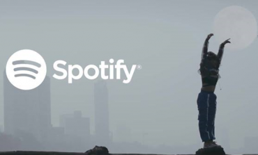 Spotify registered 100 million paid subscribers and first quarterly loss